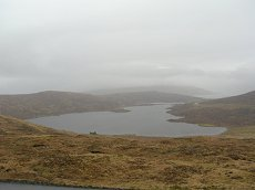 View of Toftir Lake (Toftavatn) on a misty day
