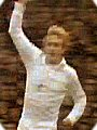 Denis Law celebrates scoring whilst wearing the 1970's Manchester United away kit