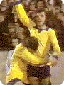 George Best clebrates coring whilst wearing the 1970's Manchester United yellow third kit